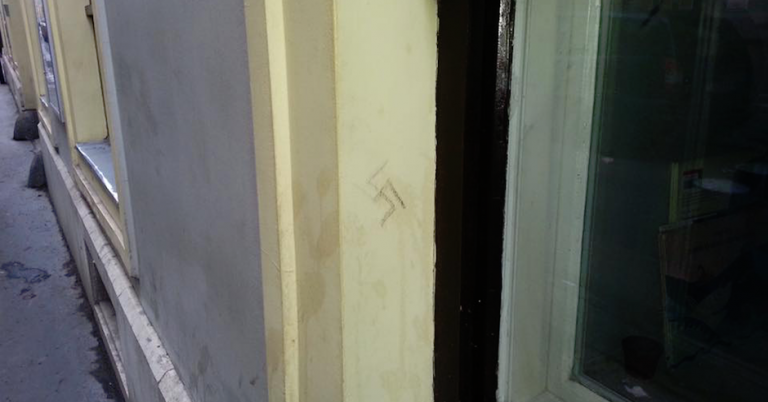 Swastika carved in the wall of a Jewish institution in Budapest