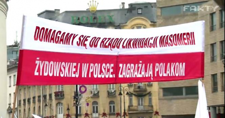 "Banner at Polish march: ""We demand the immediate liquidation of masonic Jewish life in Poland. It threatens Poles."""