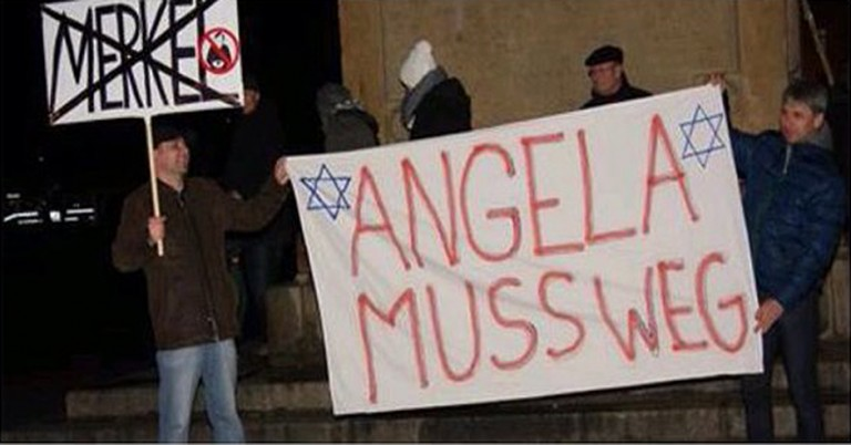 Antisemitic banner at anti-immigration demonstration in Germany