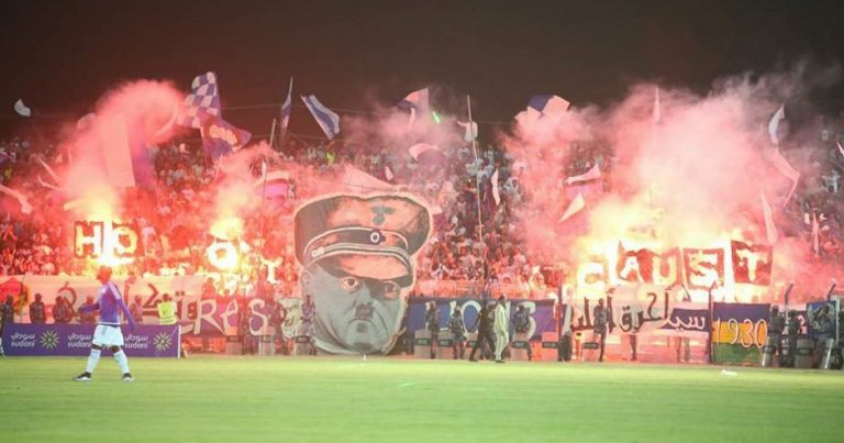 "Football fans in Sudan display banner of Hitler's face with the word ""Holocaust"" in ""gruesome first"" for the country"
