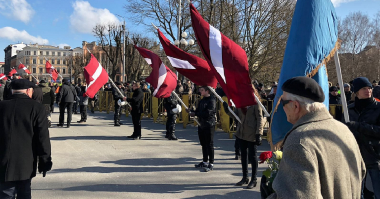 Hundreds march with former SS officers in Latvia, one arrested